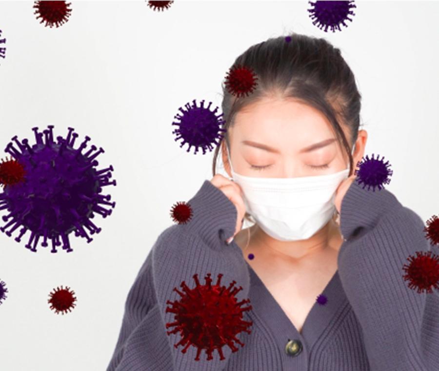 ウィルスの中にいるマスクをした女性